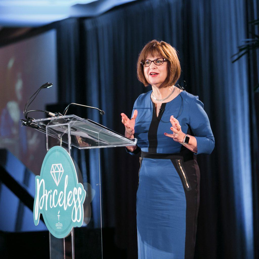 Doctor Sandra Morgan speaking at Priceless Luncheon.
